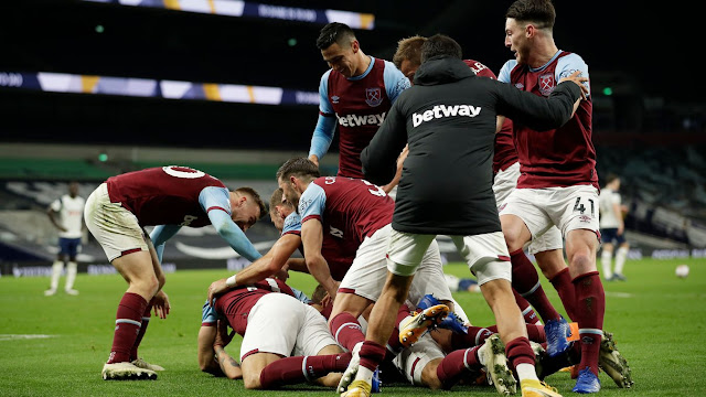 West Ham players celebrates with Manuel Lanzini as he scores the winning goal in their 3-3 comeback at Tottenham