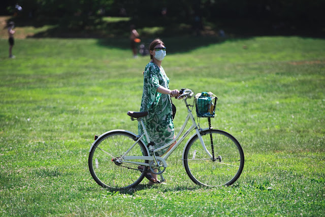 A lady on a bike with face mask in Brooklyn