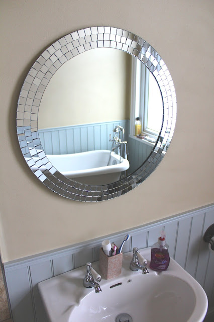 mosaic mirror above basin in bathroom
