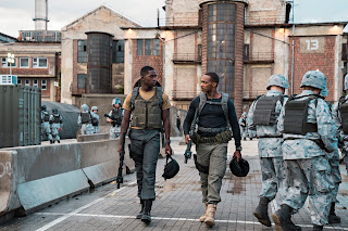 Damson Idris and Anthony Mackie as soldiers