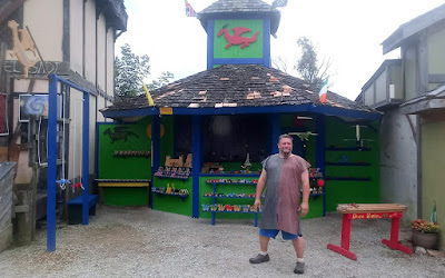 Man standing in front of toy shop