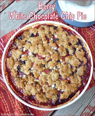 Berry White Chocolate Chip Pie features berries, baked into a pie crust topped with a white chocolate chip crumble. | Recipe developed by www.BakingInATornado.com | #recipe #dessert