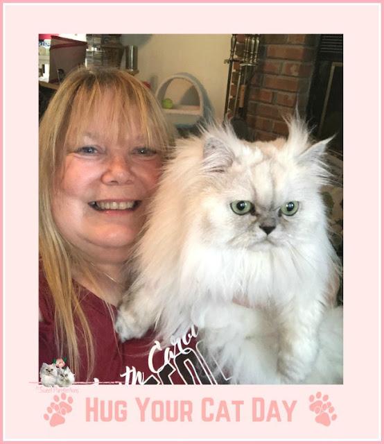 Paula holding Persian cat, Truffle