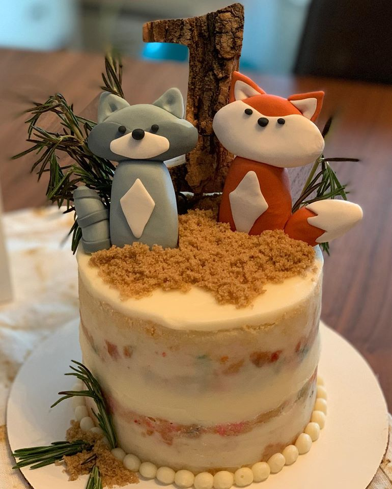 forest friends first birthday cake