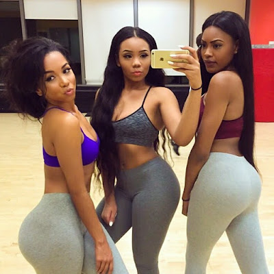 Girls taking selfie in gym