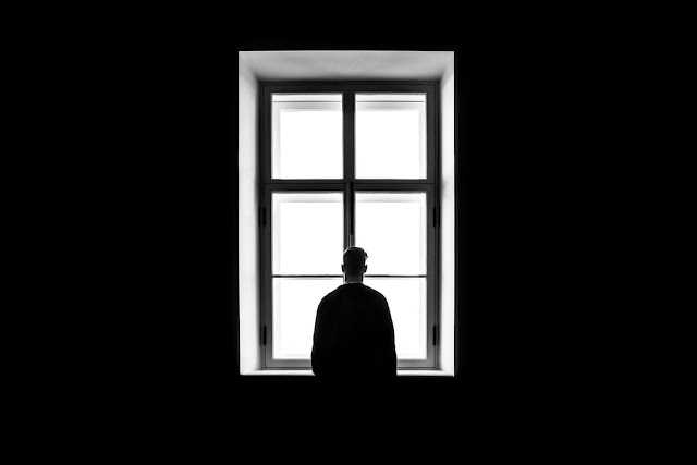 Person in front of a window