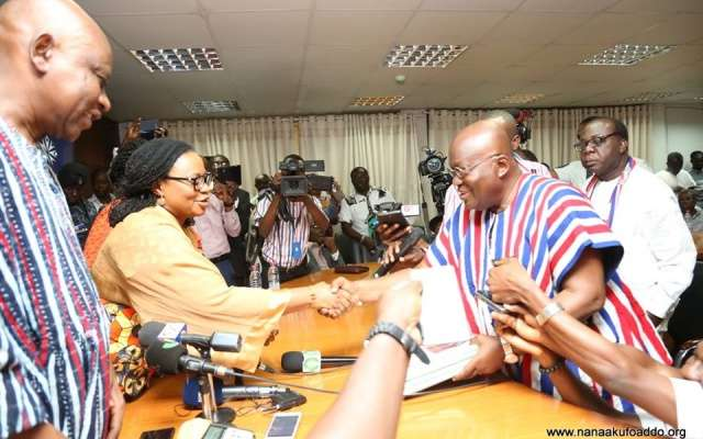 EC boss Charlotte Osei receiving nomination forms from Nana Akufo-Addo