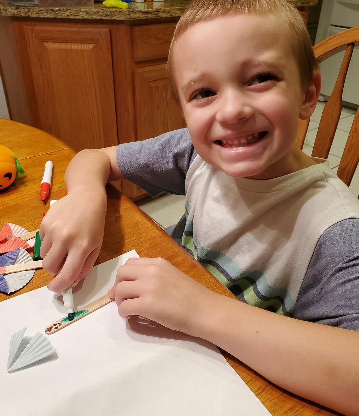 this is a craft with my grandson making popsicle stick super heroes