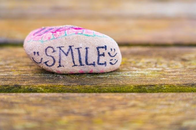 Senyumanmu II Puisi
