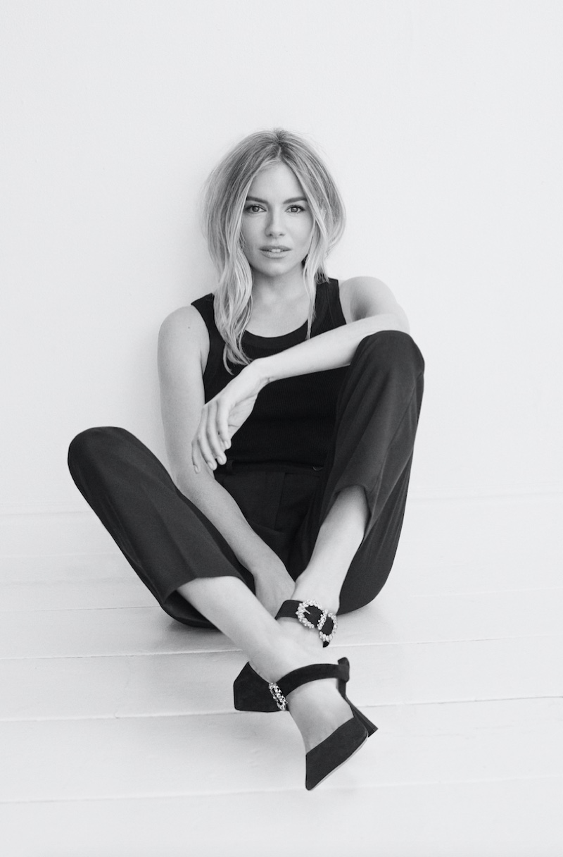 Actress Sienna Miller poses in Jimmy Choo Smokey pumps