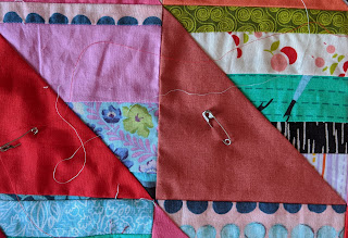 Both thread colors are laid on the quilt top to choose which one works better.
