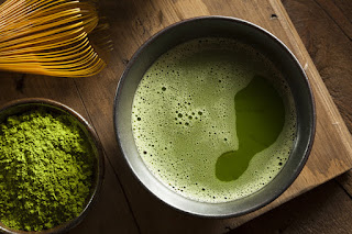 Pic of Japanese frothy Japanese green tea, matcha tea powder and tea whisk