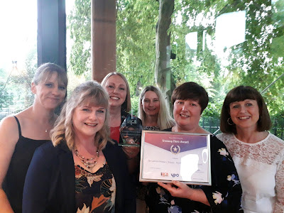 Photograph of the team from Broughton Primary School accepting the Unsung Heroes award at the ceremony on Friday 14 June 2019.