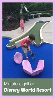 Playing miniature golf at Walt Disney World Resort