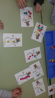 http://www.totschooling.net/2015/12/snowman-buttons-counting-printable.html