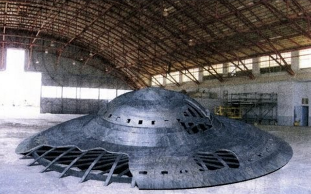 UFO or Flying Saucer inside a warehouse type building.