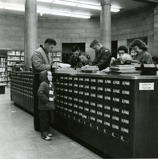 Vintage photo. c.1950s Dad and daughter use a large card catalog at the library. Talk Dewey To Me. marchmatron.com
