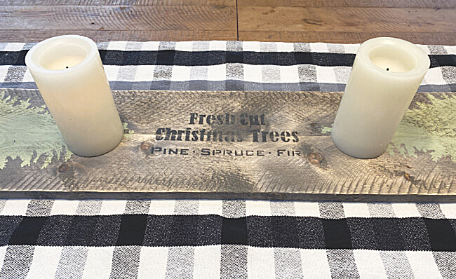 Wooden table runner with christmas trees and candles
