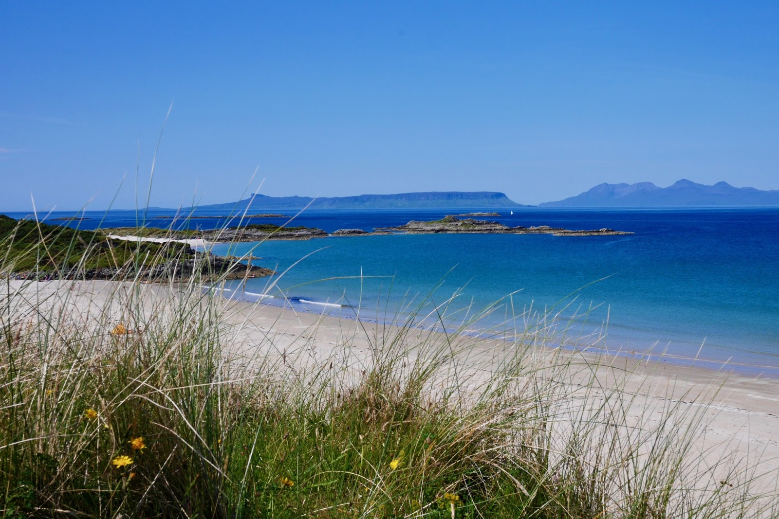 Stunning beaches of Arisaig where clear blue waters are met by white sandy beaches , www.calmctravels.com