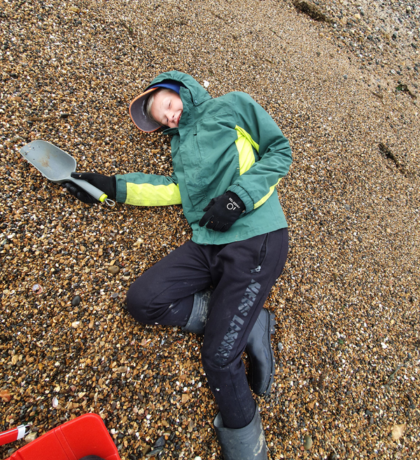 Fossil hunting at 8am for the low tide with a tired boy