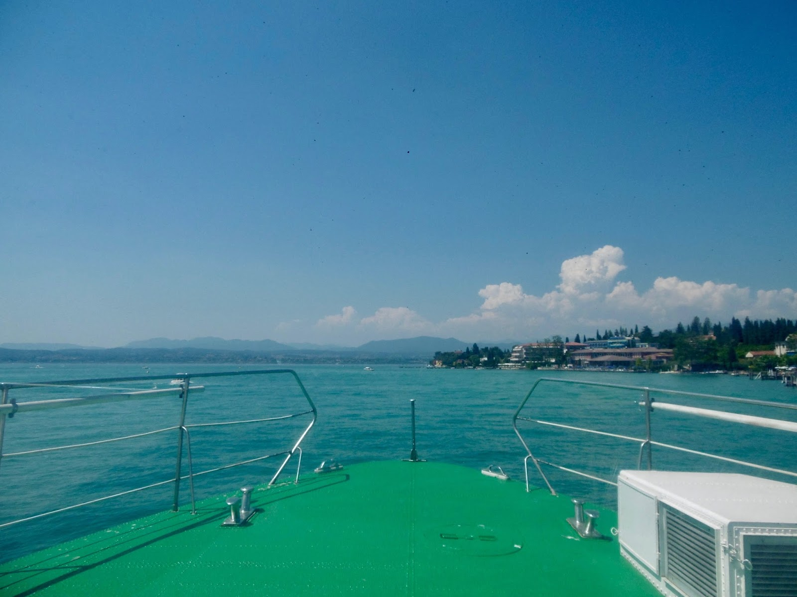 riding a boat in Lake Garda