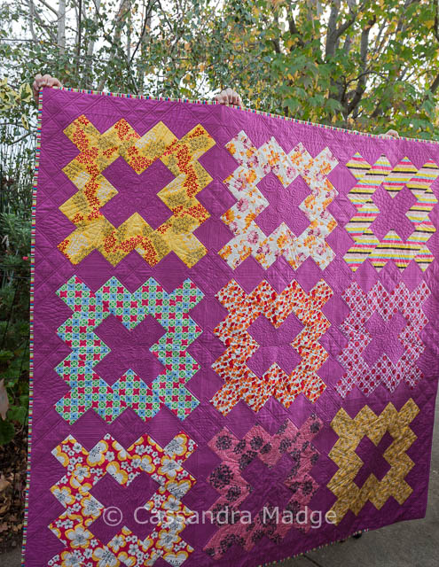 Vibrant pink geometric quilt by Cassandra Madge