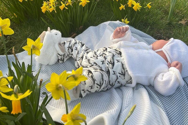 The newborn baby August was sporting a knit cap and sweater, a onesie with whales on it, and some sweet bunny slippers. Sarah Ferguson