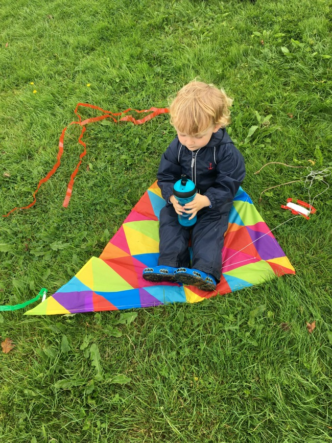 toddler-sat-on-kite-with-tommee-tippee-filter-cup