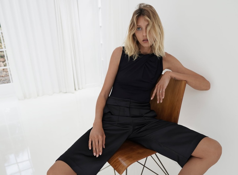Model Anja Rubik dresses in black for Zara summer 2020 style guide.