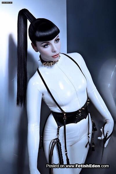 Brunette Mistress wearing white latex catsuit