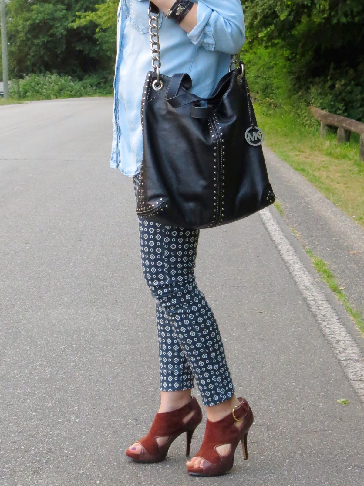 printed pants, chambray shirt, and Michael Kors bag