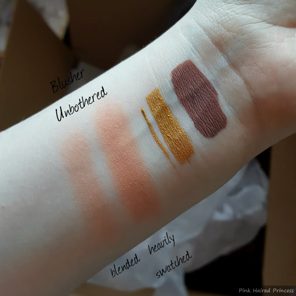 asos blusher in unbothered swatched on arm lightly and heavily