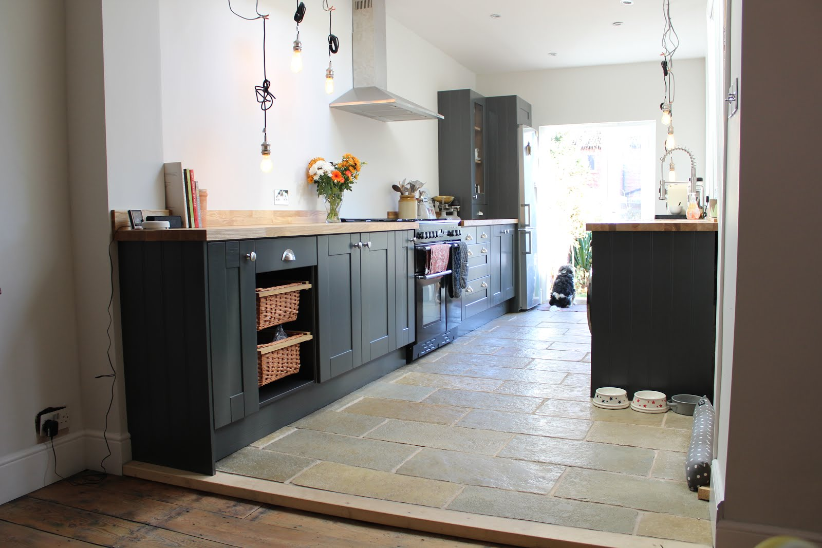 Limestone floor in dark grey kitchen