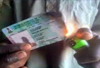 HARDSHIP: Frustrated Lagos Voter REGRETS Voting Buhari, Sets Voters Card Ablaze; See Photos