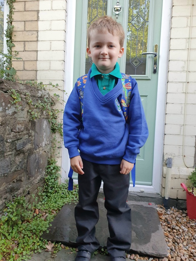 Bear-looking-proud-in-school-uniform-in-front-of-his-front-door
