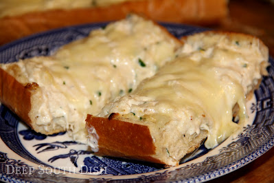 Crabmeat mixed with a tangy blend of sour cream and mayo, layered on French bread with cream cheese and Monterey Jack cheese. Cut into slices and serve hot for a great appetizer!