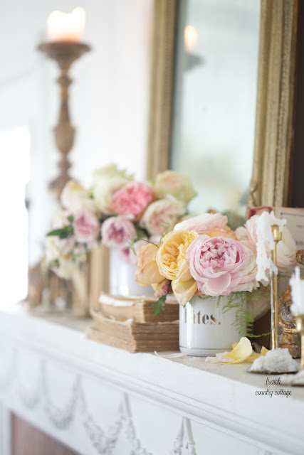 Roses and flowers in french enamel canister in a mantel styling