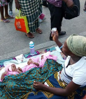 Woman Who  Gave Birth To Triplets In Port-Harcourt Found On the Street Begging For Money To Feed Them