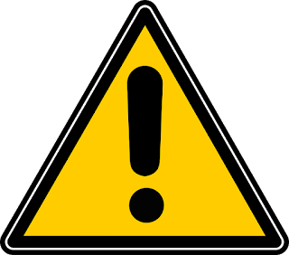 Yellow triangle, point at top, with black border and black exclamation mark to indicate a warning