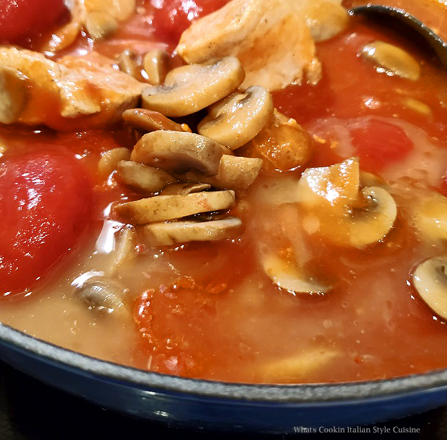 this is a delicious mushroom stew with whole tomatoes and pork call boscaiola sauce a dish made famous in Tuscany Italy