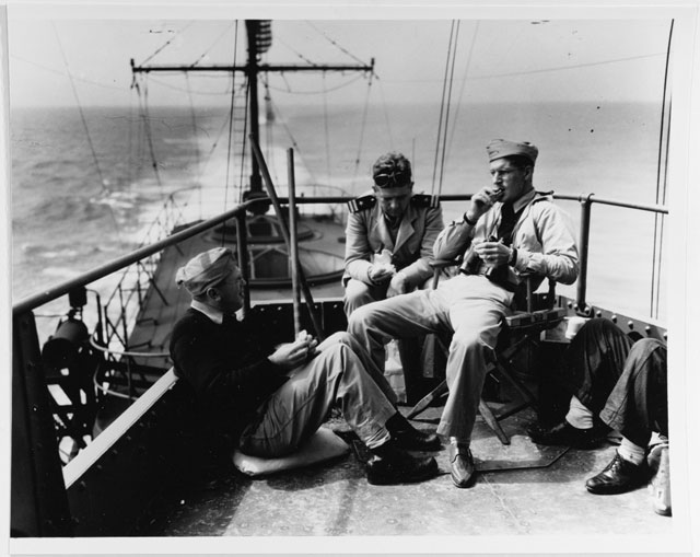 Men relaxing on USS Enterprise, 25 March 1942 worldwartwo.filminspector.com
