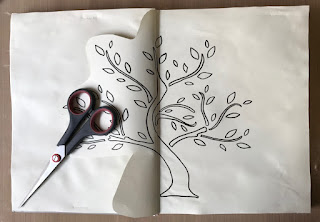 image tree outline in art journal with scissors