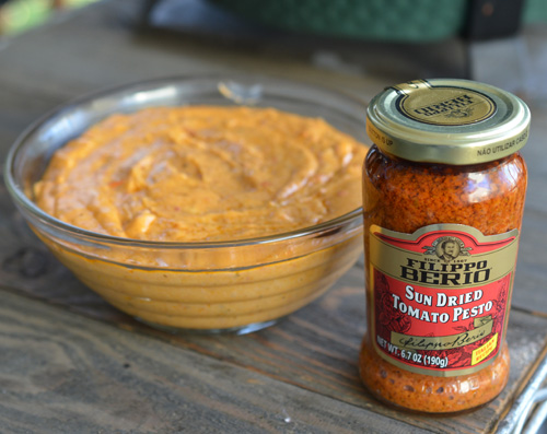 Try using sun-dried tomato pesto to jazz up your pizza sauce.