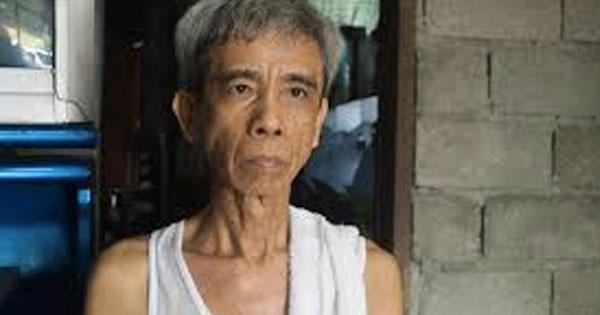 صورة ارشيفية لوالد المصاب فى الصين