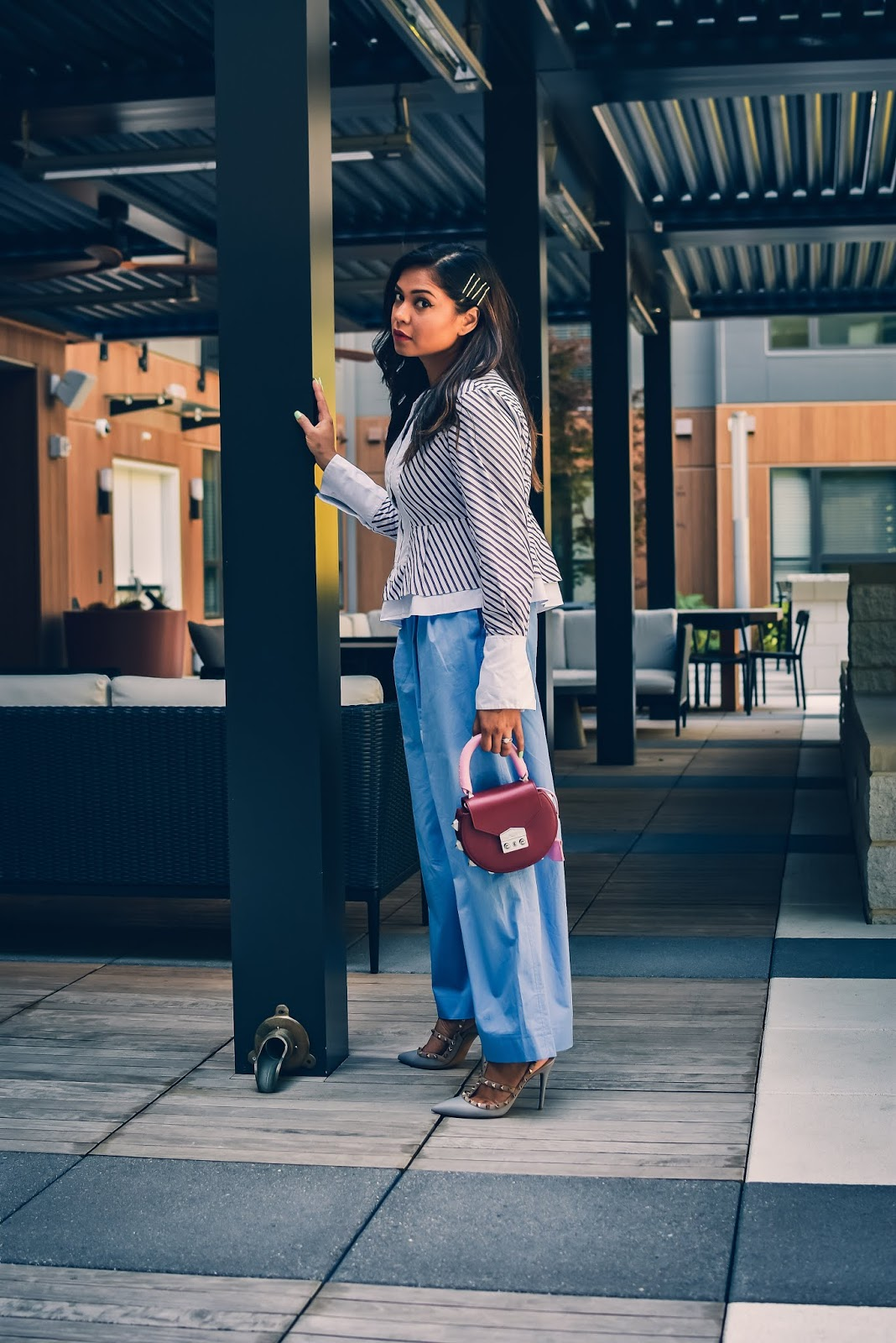 how to wear wide leg pants in summer, culottes, blue wide leg pants, angled shirt, peplum hem top, valentino rockstud heels, burgundy handle bag, stripe shirt, red white and blue, saumya shiohare