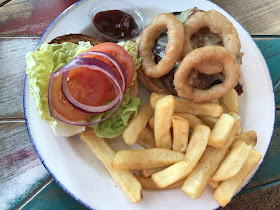 Backyard BBQ burger with chips and onion rings and BBQ dip