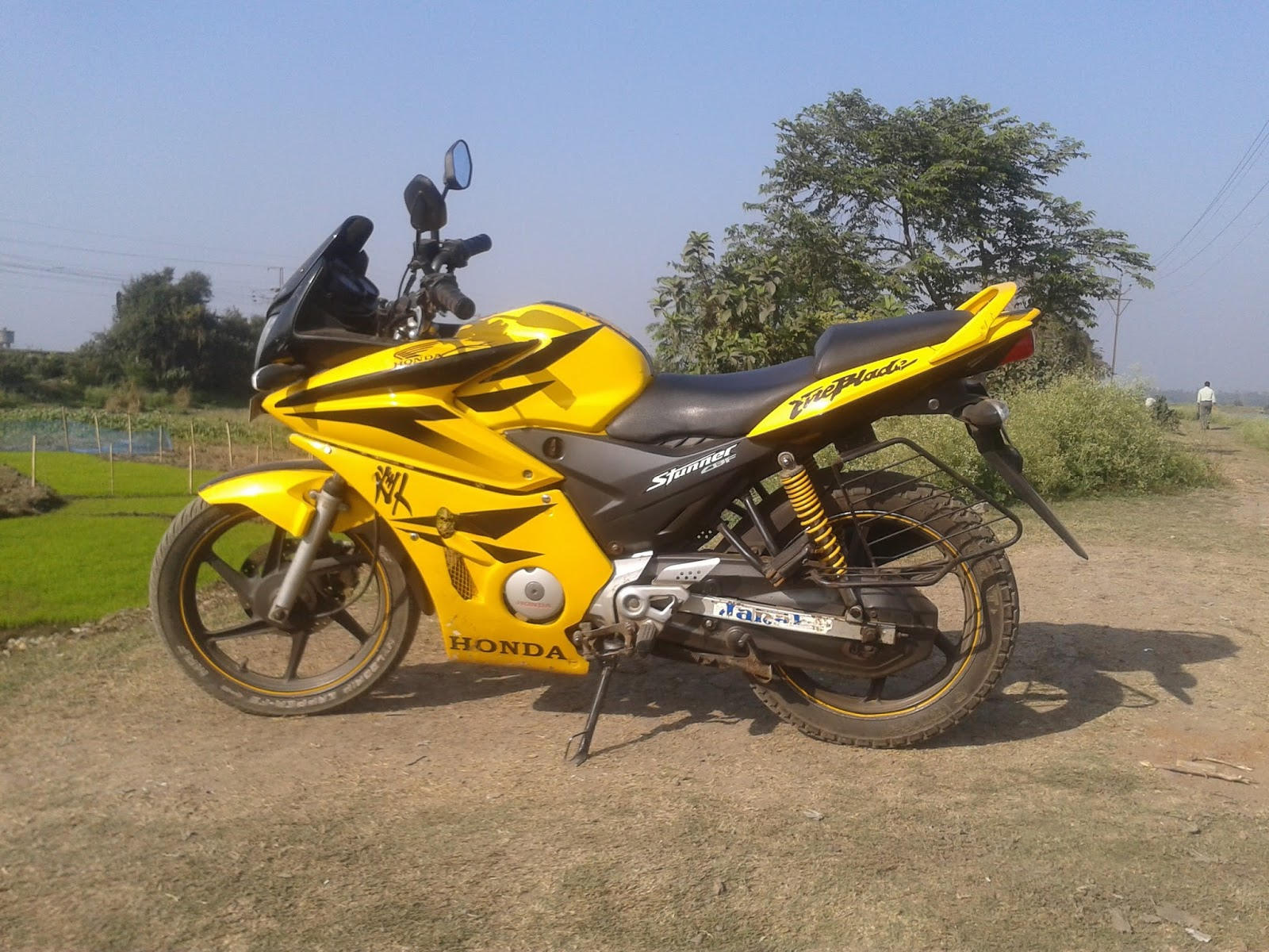 My modified yellow honda stunner cbf 125 kick start+self start with disc brakes 2009 model