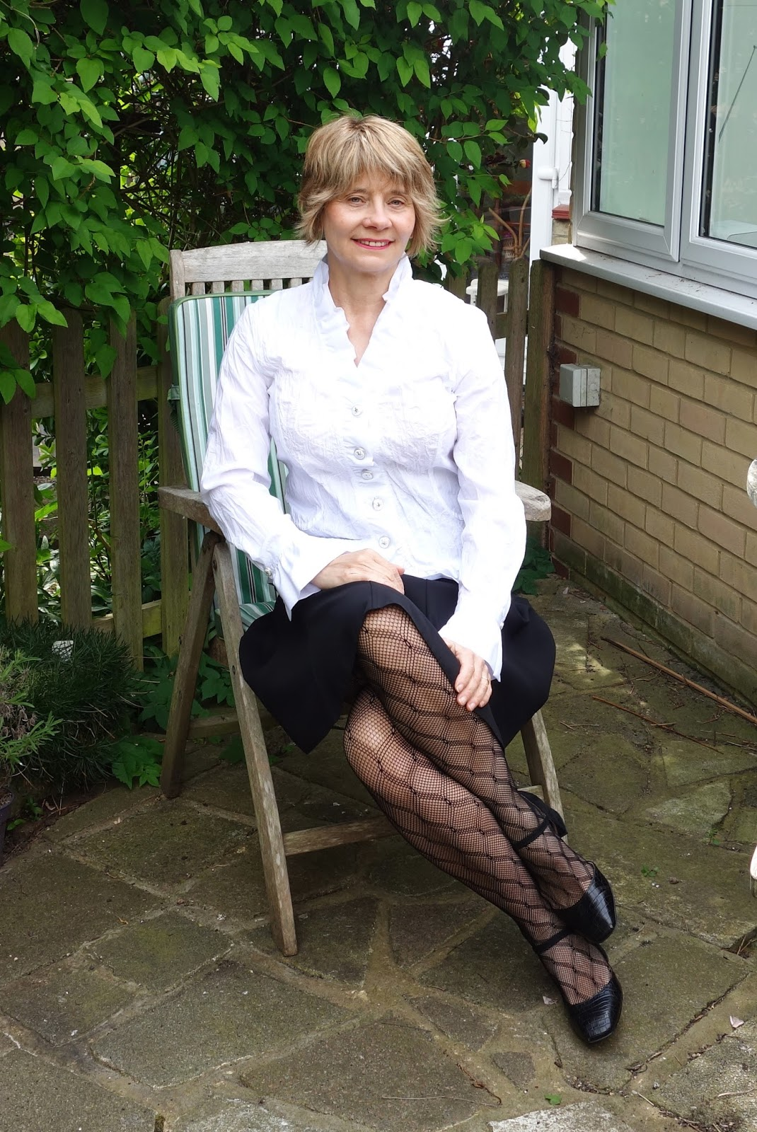 Styling a smart work outfit for summer with black diamond net tights from Charnos