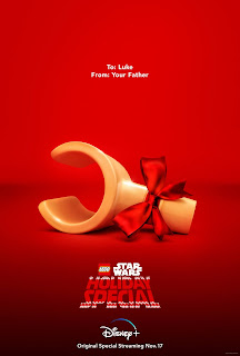 Lego hand tied with a bow - message reads To: Luke, From: Your Father