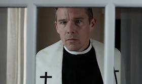 Priest in window